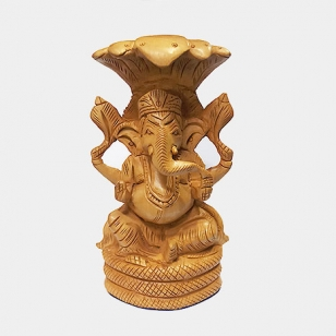 Wooden Ganesh sitting on Snake